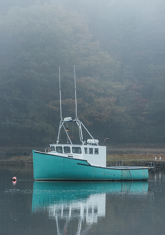 Fishing boat in morning mist, Kennebunk, Maine, USA.