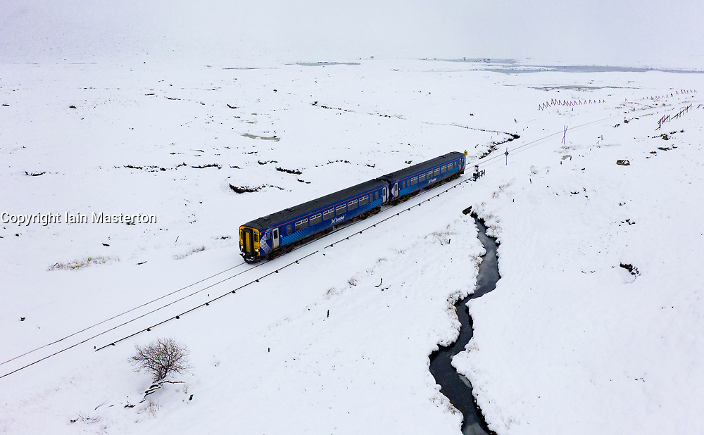 Corrour, Scotland, UK. 28 January, 2020.  A Scotrail train travels through heavy snow at Corrour on it's way from Glasgow to Mallaig on the West Highland Line. Corrour Station is the highest railway in Britain at a height of 1338 feet above sea level. Iain Masterton/Alamy Live News.