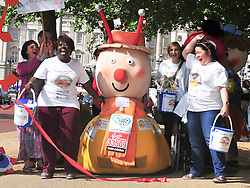 © licensed to London News Pictures. London, UK  14/06/11 A charity worker who crawled the London Marathon dressed as Brian the Snail from The Magic Roundabout has been sacked for not raising enough money. FILE PICTURE DATED 13/05/11. Charity Fund raiser Lloyd Scott crosses in finish line in The Mall London after 26 days on the course of the London Marathon dressed as a giant snail . See special instructions for usage rates. Photo credit should read AlanRoxborough/LNP