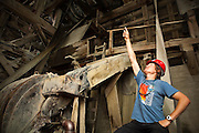 St. Elias Alpine Guides tour guide Ben Wilcox points enthusiastically during a tour of the impressive mill building in Kennecott, Alaska, site of the historic Kennecott Copper Mine.