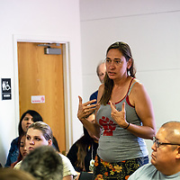 Lori Glover from West Texas asks the Standing With Standing Rock panel questions at the book launch event Saturday afternoon at the Octavia Fellin Public Library in Gallup.