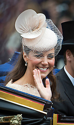 © London News Pictures. 05/06/2012. London, UK.  Catherine Duchess of Cambridge travels by coach down The Mall  to Buckingham palace as part of the Diamond Jubilee Carriage procession on June 5, 2012.  Photo credit: Ben Cawthra/LNP