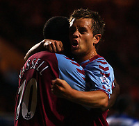 Photo. Daniel Hambury.Digitalsport<br /> Carling Cup.<br /> 22/09/2004.<br /> Aston Villa V Queens Park Rangers<br /> Aston Villa's Lee Hendrie celebrates with goal scorer Darius Vassell