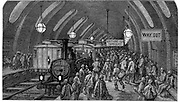 The Workmen's Train'. From Gustave Dore and Blanchard Jerrold 'London: A Pilgrimage' London 1872. This picture shows steam trains at Gower Street station on the Metropolitan (underground) railway which opened in 1863. Workers hurry to catch their morning train. Wood engraving