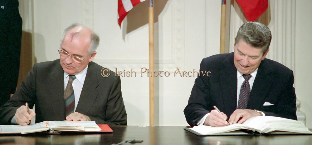 Soviet leader Mikhail Gorbachev and US President Ronald Reagan signing the INF Treaty 1987