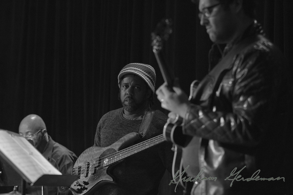 Legendary bassist Victor Wooten listens to a solo by young virtuoso guitarist James DaSilva while drumming legend Chester Thompson holds down the groove. (Now that's a rhythm section!)