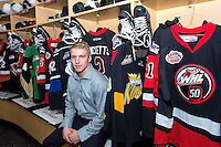 KELOWNA, CANADA - NOVEMBER 9: Joe Hicketts #2 of Team WHL and the Victoria Royals sits in the dressing room on November 9, 2015 during game 1 of the Canada Russia Super Series at Prospera Place in Kelowna, British Columbia, Canada.  (Photo by Marissa Baecker/Western Hockey League)  *** Local Caption *** Joe Hicketts;