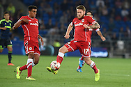 Aron Gunnarsson of Cardiff city (17) watched by teammate Tom Adeyemi (l). .Skybet football league championship match, Cardiff city v Middlesbrough at the Cardiff city stadium in Cardiff, South Wales on Tuesday 16th Sept 2014<br /> pic by Andrew Orchard, Andrew Orchard sports photography.