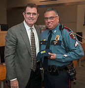 Houston ISD superintendent Dr. Terry Grier recognizes Officer Gilbert Garcia during a Central Office staff meeting, April 8, 2014.