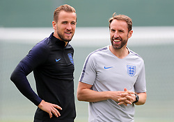 England's Harry Kane (left) with manager Gareth Southgate during the training session at the Spartak Zelenogorsk Stadium, Repino.