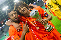 Tonny Trindade de Vilhena of Netherlands and Nathan Ake of Netherlands celebrate with a trophy after winning the UEFA European Under-17 Championship Final match between Germany and Netherlands on May 16, 2012 in SRC Stozice, Ljubljana, Slovenia. Netherlands defeated Germany after penalty shots and became European Under-17 Champion 2012. (Photo by Vid Ponikvar / Sportida.com)