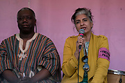 Climate lawyer Farhana Yamin addresses the audience, audience at the Marble Arch Extinction Rebellion camp, sitting next to Kofi Mawuli Klu. Several roads were blocked across four sites in central London, by the Extinction Rebellion climate change protests, April 2019.