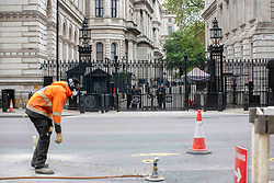 Street workers in front of Downing Street, London, UK on April, 2020. Photo by Erica Dezonne/ABACAPRESS.COM