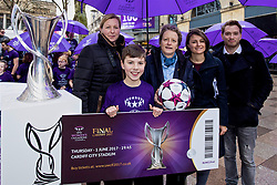 CARDIFF, ENGLAND - Tuesday, February 21, 2017: Stefan Roberts, the first person to buy a ticket poses with Jayne Ludlow, 2017 Women's Champions Legue Final Ambassador, Karen Espelund, UEFA Chair of Women's Football Committee, Capitol FM Radio Presenters and the Champions League trophy in the Hayes, Cardiff to promote the UEFA Champions League Finals being staged in Cardiff this June. (Pic by Paul Greenwood/Propaganda)