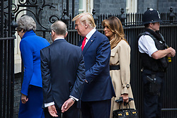 London, UK. 4 June, 2019. US President Donald Trump, First Lady Melania Trump, Prime Minister Theresa May and her husband Philip May enter 10 Downing Street for lunch and talks on the second day of his state visit to the UK.