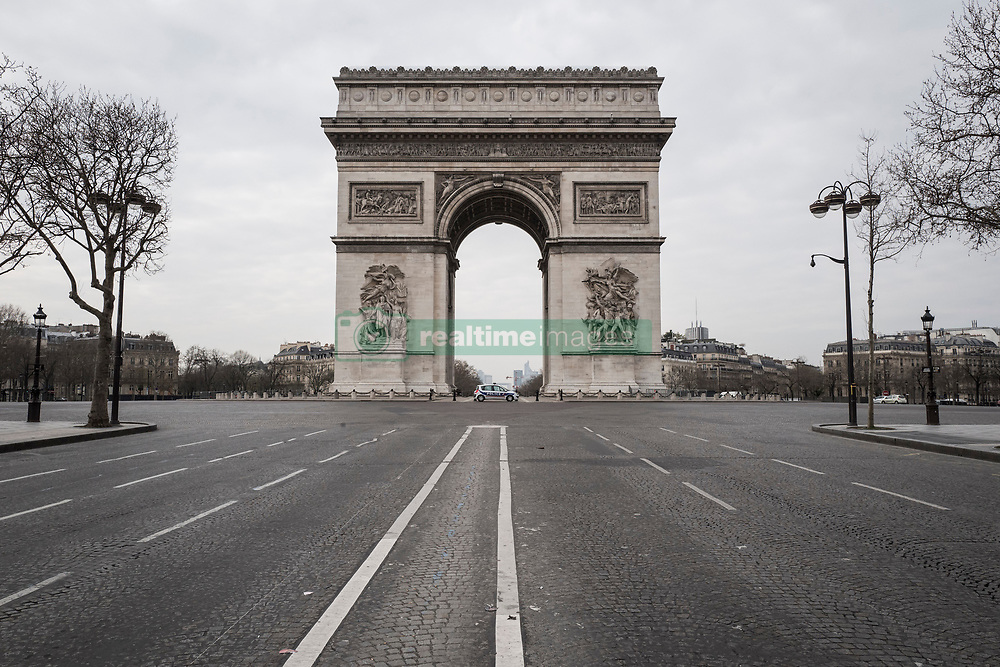 March 17, 2020, Paris, France: The Arc de Triomphe. during confinement in France to fight against the coronavirus (Credit Image: © Adrien Vautier/Le Pictorium Agency via ZUMA Press)
