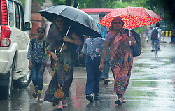 July 4, 2017 - Allahabad, Uttar Pradesh, India - People use umbrella to being safe with rain shower. (Credit Image: © Prabhat Kumar Verma/Pacific Press via ZUMA Wire)
