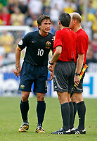 Photo: Glyn Thomas.<br />Brazil v Australia. Group F, FIFA World Cup 2006. 18/06/2006.<br /> Australia's Harry Kewell (L) angrily confronts referee Markus Merk (C) after the full-time whistle.