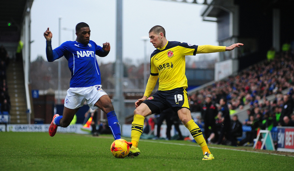 Fleetwood Town's Jamie Proctor vies for possession with Chesterfield's Tendayi Darikwa<br /> <br /> Photographer Chris Vaughan/CameraSport<br /> <br /> Football - The Football League Sky Bet League One - Chesterfield v Fleetwood Town - Saturday 28th February 2015 - Proact Stadium - Chesterfield<br /> <br /> © CameraSport - 43 Linden Ave. Countesthorpe. Leicester. England. LE8 5PG - Tel: +44 (0) 116 277 4147 - admin@camerasport.com - www.camerasport.com