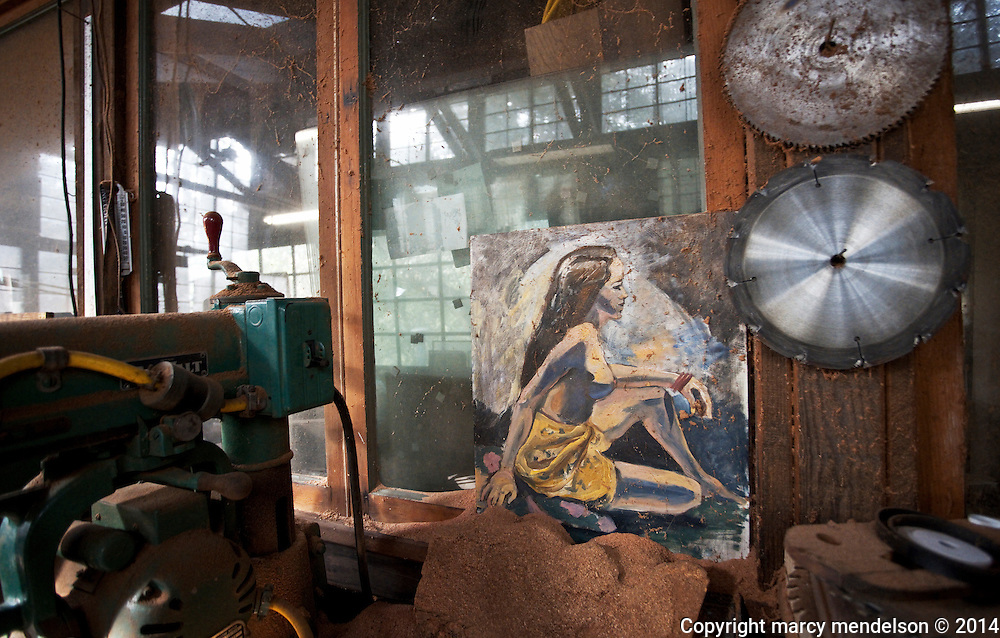 Ed Stiles has lived at Druid Heights for over 49 years and built many of the structures such as his still functioning workshop.  He keeps an early painting by his wife, Marilyn, in his artist studio.