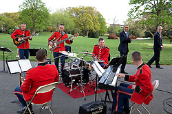 "President Barack Obama and Chief of Staff Denis McDonough listen to the ""Jazz Combo of 'The President's Own' U.S. Marine Band"" who were playing for the President's Medicare Sustainable Growth Rate reception in the Rose Garden of the White House, April 21, 2015. (Official White House Photo by Pete Souza)<br /> <br /> This official White House photograph is being made available only for publication by news organizations and/or for personal use printing by the subject(s) of the photograph. The photograph may not be manipulated in any way and may not be used in commercial or political materials, advertisements, emails, products, promotions that in any way suggests approval or endorsement of the President, the First Family, or the White House."