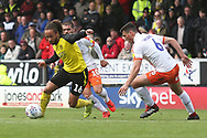 Burton Albion midfielder Marcus Harness (16) goes past Luton Town defender Matty Pearson (6) during the EFL Sky Bet League 1 match between Burton Albion and Luton Town at the Pirelli Stadium, Burton upon Trent, England on 27 April 2019.