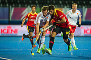 England's Harry Martin is tackled by Salvandor Piera of Spain. England v Spain - Unibet EuroHockey Championships, Lee Valley Hockey & Tennis Centre, London, UK on 25 August 2015. Photo: Simon Parker