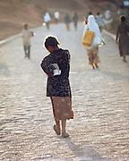 Young girl carrying books, Lalibela, Ethiopia.