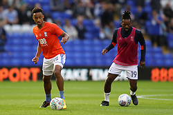 Birmingham City's Cohen Bramall (left) warms up before the Carabao Cup, Second Round match at St Andrew's, Birmingham.