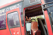 Bus driver relaxing in his bus  in Seoul, South Korea, Republic of Korea, KOR, 25 April 2010.