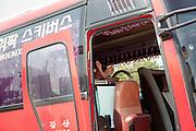 Bus driver relaxing in his bus  in Seoul, South Korea, Republic of Korea, KOR, 25 April 2010.