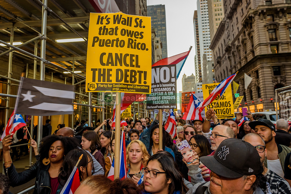 October 3, 2017 - New York, New York, United States - Call to Action in Puerto Rico and Pro Libertad called for a picket/rally in front of the Trump Tower in Manhattan. Hundreds took to the streets in solidarity with the groups in Puerto Rico mobilizing to protest Trump's first visit after hurricane Mary. (Credit Image: © Erik Mcgregor/Pacific Press via ZUMA Wire)