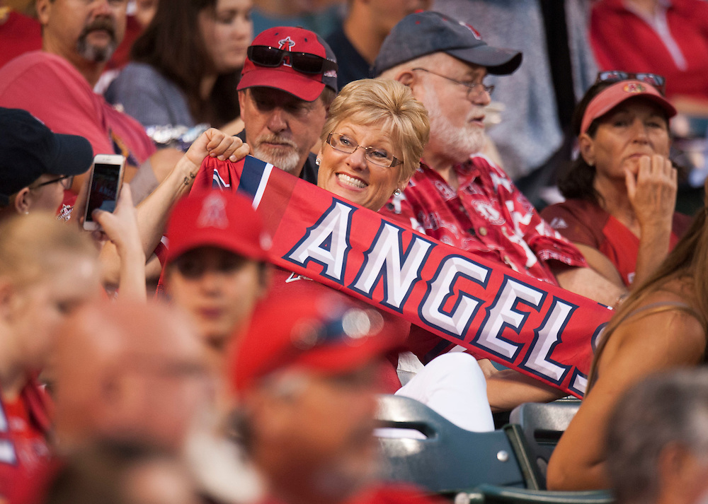 An Angel fan shows off her giveaway soccer scarf during the Angels' 5-4 victory over the Oakland Athletics at Angel Stadium on Tuesday.<br /> <br /> ///ADDITIONAL INFO:   <br /> <br /> angels.0803.kjs  ---  Photo by KEVIN SULLIVAN / Orange County Register  -- 8/2/16<br /> <br /> The Los Angeles Angels take on the Oakland Athletics at Angel Stadium.