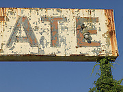 abandoned gasoline sign