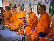 01 JANUARY 2016 - BANGKOK, THAILAND:        Buddhist monks chant and meditate during the annual New Year's mass merit making ceremony on at Sanam Luang in Bangkok. The ceremony is sponsored by the Bangkok city government. More than 500 Buddhist monks participated in the ceremony this year. Thais usually go to temples and religious observances to meditate and make merit on New Year's Day.     PHOTO BY JACK KURTZ