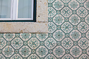 Details of ceramic tiles facades in Madragoa district in Lisbon.