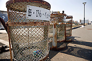old rusty roadside recycle garbage bins Japan