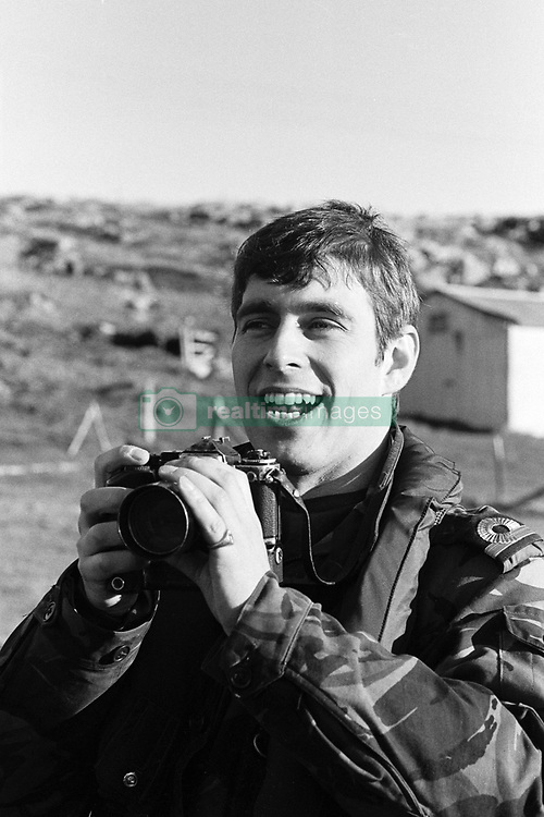 Prince Andrew, recording fro private posterity, scenes at Port Stanley after the Falklands conflict in which he took part as a helicopter pilot with HMS Invincible.