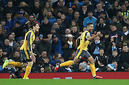 Theo Walcott of Arsenal (r) celebrates the opening goal during the English Premier League match at the Etihad Stadium, Manchester. Picture date: December 18th, 2016. Picture credit should read: Simon Bellis/Sportimage