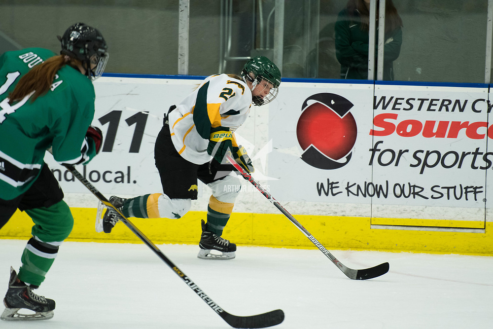 Action during the Women's Hockey Homeopener on October 7 at Co-operators arena. Credit: Arthur Ward/Arthur Images
