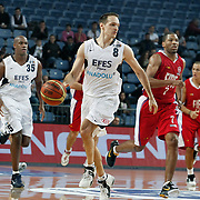 Efes Pilsen's Igor RAKOCEVIC (C), Erwin DUDLEY (L) and Tofas's Austin NICHOLS (2ndR) during their Turkish Basketball league match Efes Pilsen between Tofas at the Sinan Erdem Arena in Istanbul Turkey on Sunday 27 February 2011. Photo by TURKPIX