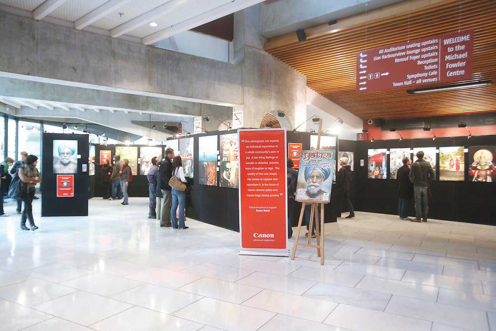 """Visitors look at photographs from India, at the Michael fowler Centre. The photo exhibition by Wellington photographer Karim Sahai and titled """"Yatra, A Photographic Journey Through India"""" was part of the october 2008 events marking Diwali, the Indian new year."""
