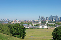 © Licensed to London News Pictures 16/06/2021. Greenwich, UK. A blue sky view across London from Greenwich park. Today could be the hottest day of the year so far with temperatures predicted to hit 30C. Photo credit:Grant Falvey/LNP