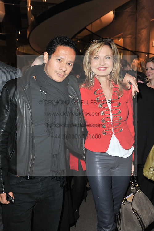 DAMIAN ANDERSON and COUNTESS MAYA VON SCHONBURG at a party to celebrate the launch of Simon Sebag-Montefiore's new book - 'Jerusalem: The Biography' held at Asprey, 167 New Bond Street, London on 26th January 2011.