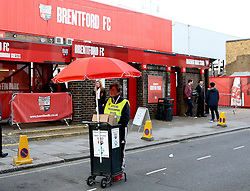 A programme seller outside Griffin Park, home of Brentford FC - Mandatory by-line: Robbie Stephenson/JMP - 05/04/2016 - FOOTBALL - Griffin Park - Brentford, England - Brentford v Bolton Wanderers - Sky Bet Championship