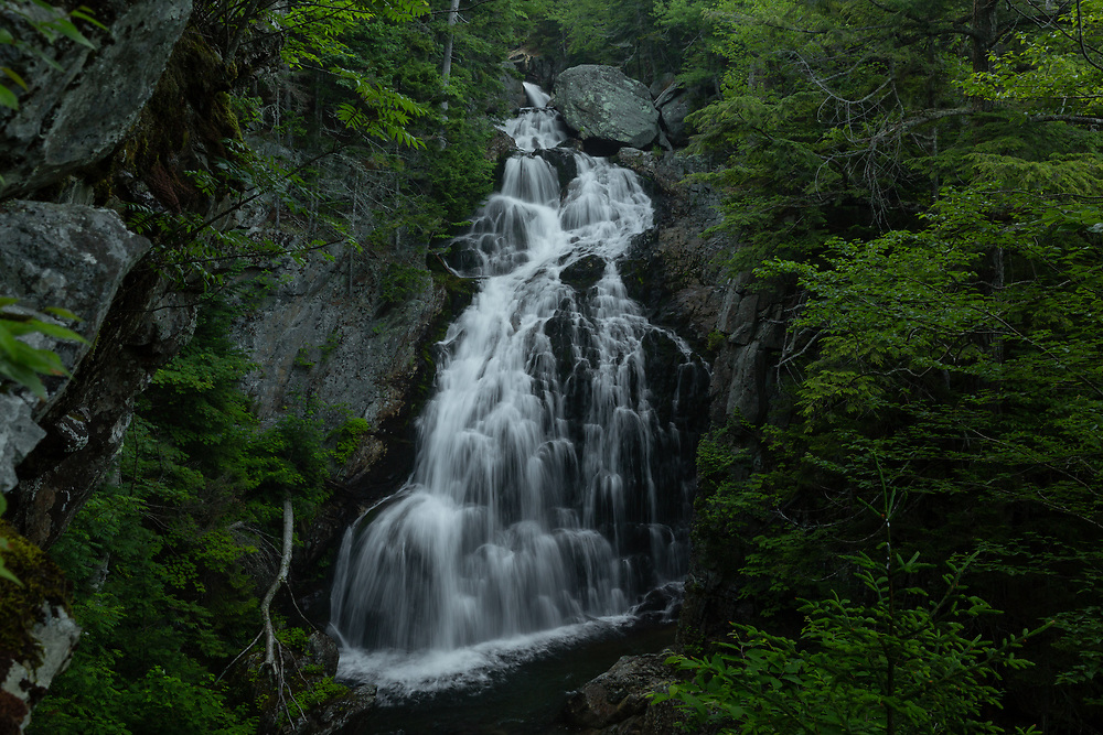 Summertime at Crystal Cascade in the mountaneous terrain of Pinkham Notch.