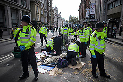 © Licensed to London News Pictures. 10/10/2019. London, UK. Police attempt to remove Extinction Rebellion activists from the roads around Trafalgar Square in Westminster, central London where they have been demonstrating for a fourth day running. The climate change group have blockaded the Westminster area, demanding that the government takes immediate and decisive action on climate change. Photo credit: Ben Cawthra/LNP