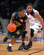 Baylor guard Henry Dugat (5) drives past Kansas State guard Clent Stewart (R) during the first half at Bramlage Coliseum in Manhattan, Kansas, January 17, 2007.  The Wildcats and Bears are tied at 39-39 at halftime.
