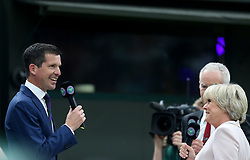 Tim Henman and Sue Barker on No.1 court at The All England Lawn Tennis Club, London.