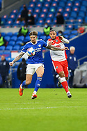 Cardiff City's Aden Flint (5) battles for possession with  Millwall's Kenneth Zohore (13) during the EFL Sky Bet Championship match between Cardiff City and Millwall at the Cardiff City Stadium, Cardiff, Wales on 30 January 2021.